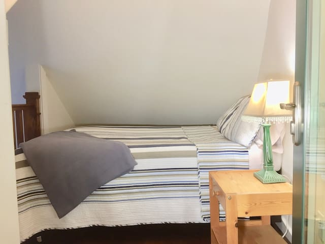 Third little sleeping area, entered from the Master enclosed balcony via the green door. A double/full bed & nightstand w/ lamp & wall lighting. Over-looks the living rm. This is a cozy little getaway for sleeping best for a single or 2 kids.