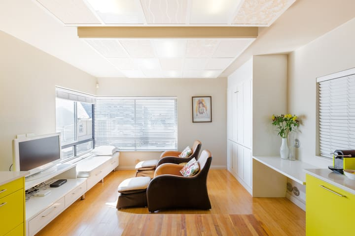 Stay in a Waterfront Designer Apartment with Pool