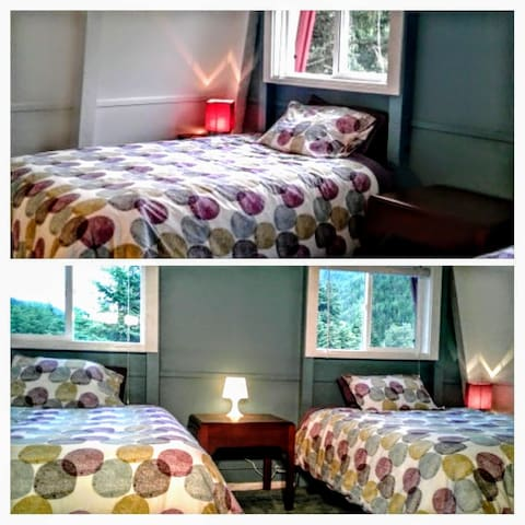 Upstairs room with 2 double beds