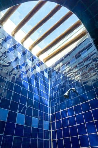 Shower detail of skylight  in bathroom of  the main house.  A Refreshing shower after your ocean swim  under the Caribbean moon.