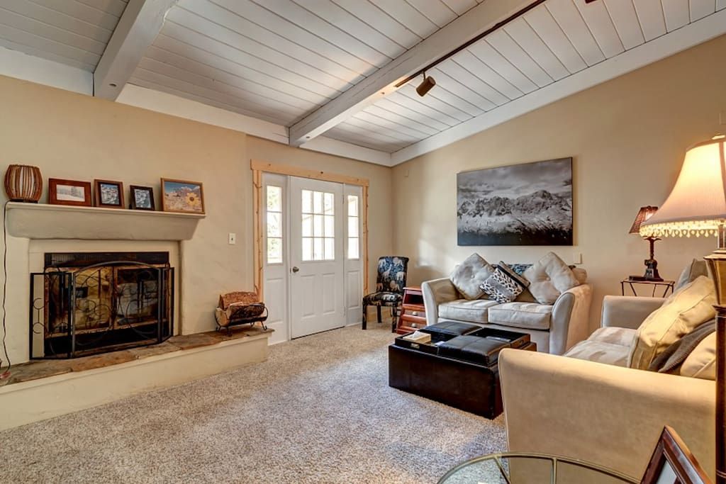 Timber vaulted ceilings feature in the living room.