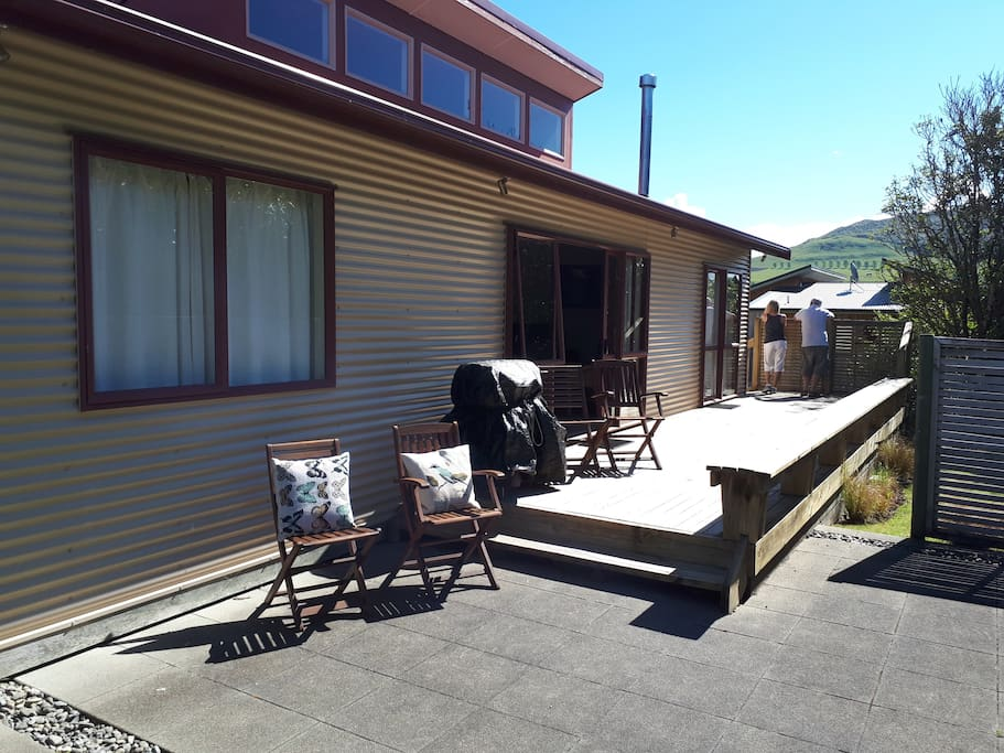 Large Outdoor deck and paved area looking out towards hills