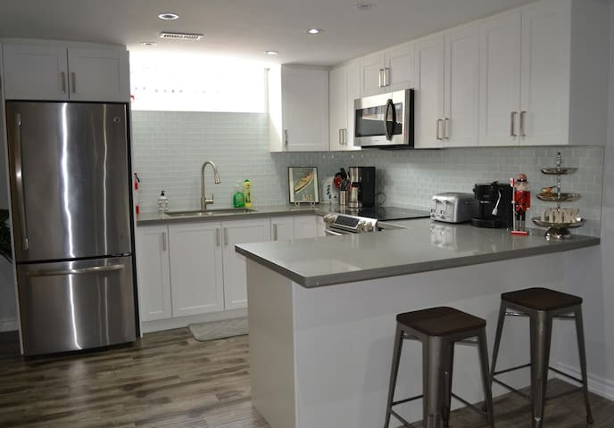 Brand new FULL kitchen with stainless steel appliances, refrigerator, freezer, stove/range/oven and microwave