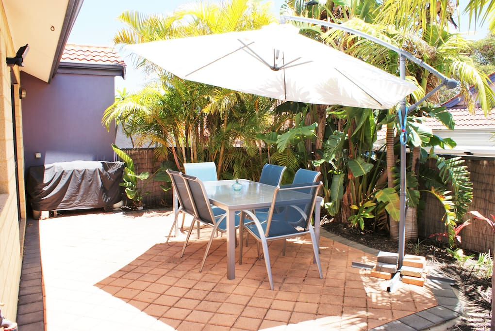 Tropical alfresco area offers a BBQ and great place to relax with a book or entertain guest