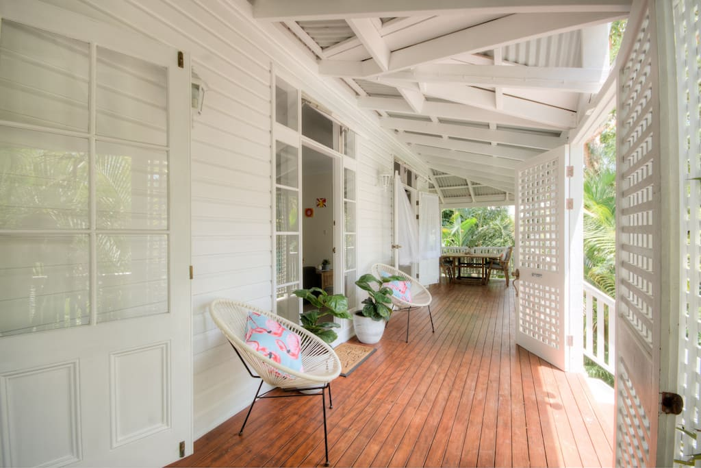 Enjoy true Queenslander style living with a  verandah that wraps 3 sides of the house