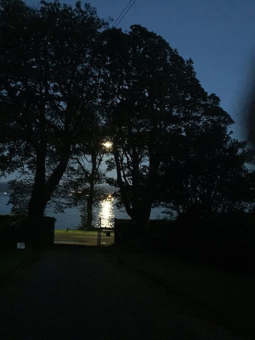Looking down toward our gates and the water, at night