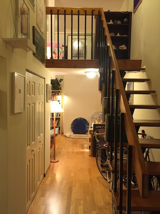 Entrance of the apartment and stairs that lead to the second floor.