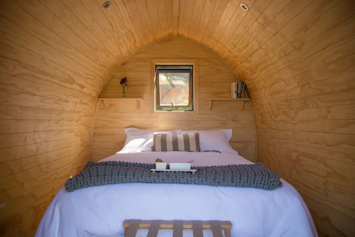 A queen bed in two pods. the Tui Pod has a King.