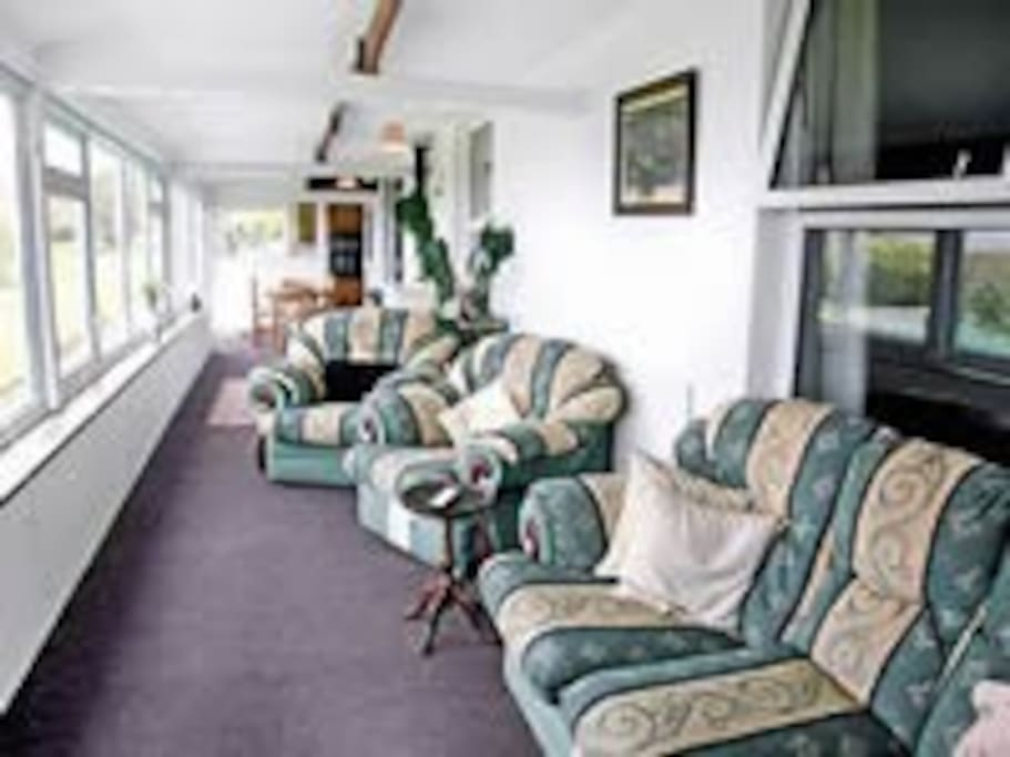 large shared conservatory with excellent countryside views to sea
