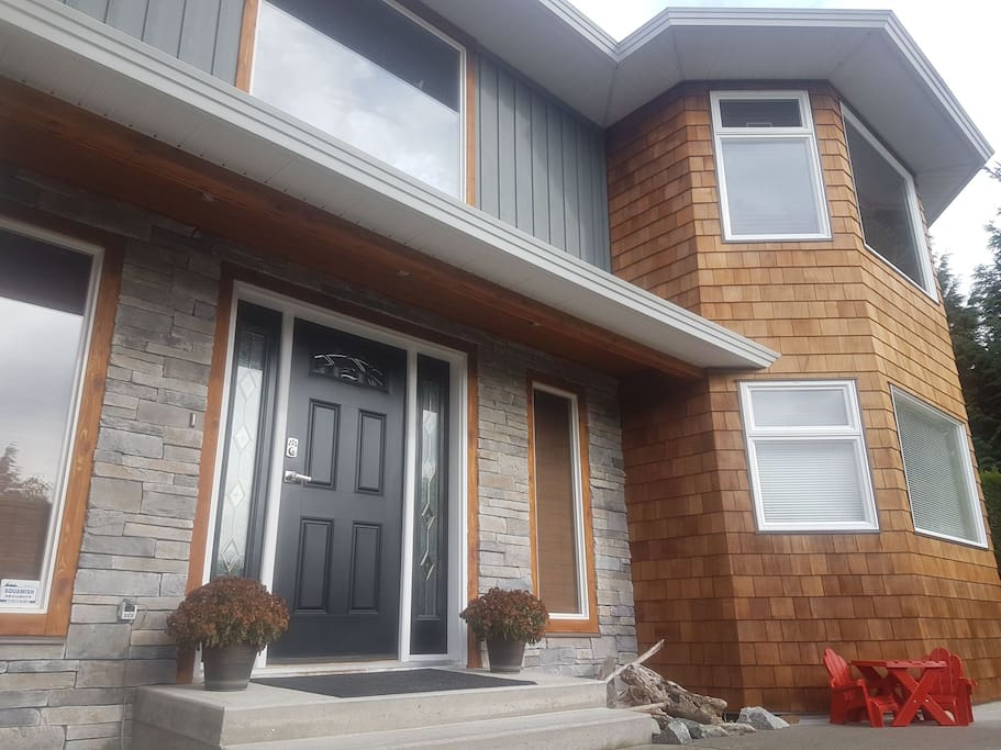 Beautiful custom stonework and cedar shake siding complement our natural surroundings