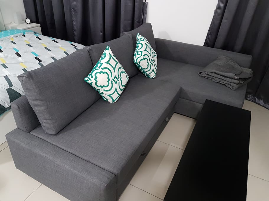 Sofa can transform into queen size bed.