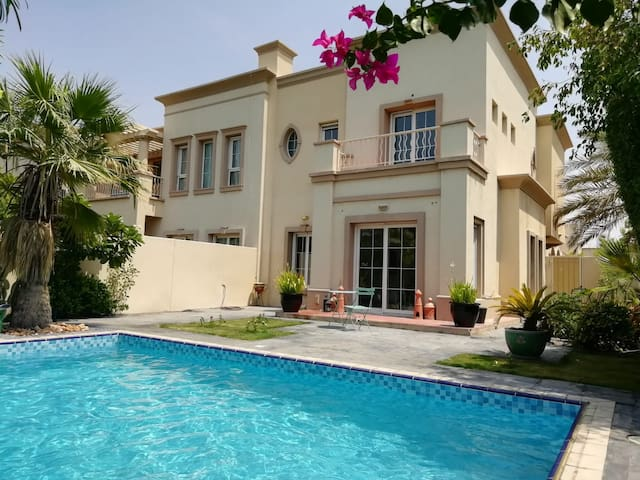 Spacious master bedroom in villa with private pool