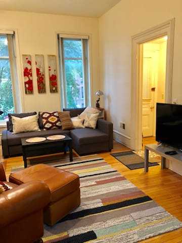 The top floor unit: living room and front entry way