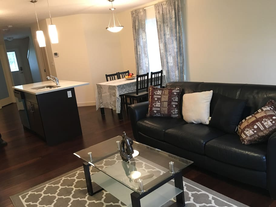 Living room with cozy leather couch and pillows to relax and enjoy watching your smart TV.