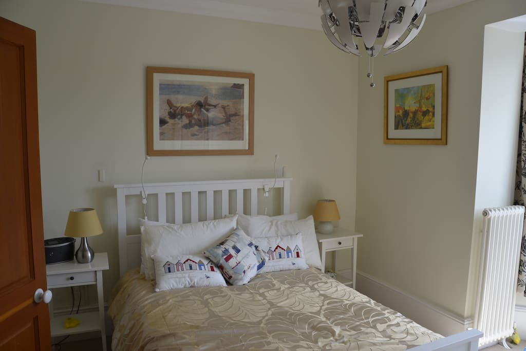 A bright double room with linen and towels