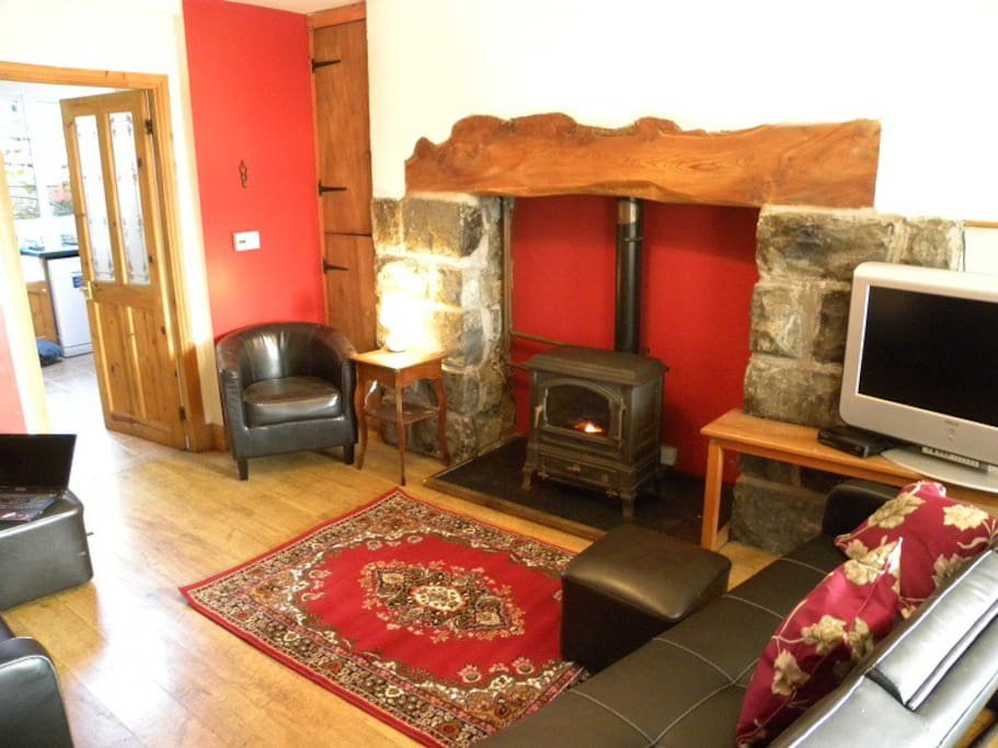 Lounge with inglenook fireplace and oil burner