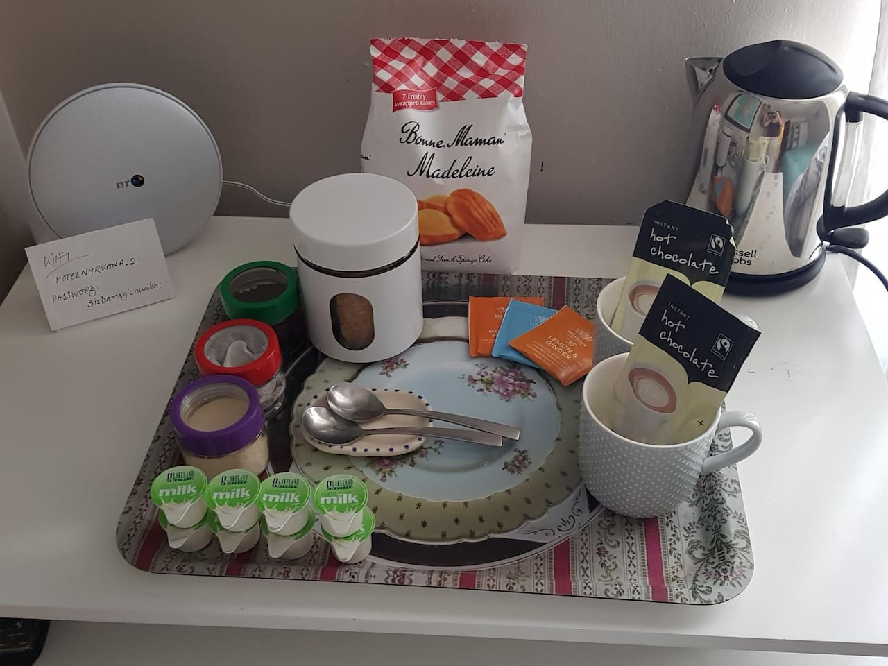 Breakfast tray with tea, coffee and hot chocolate. With a choice of snacks.