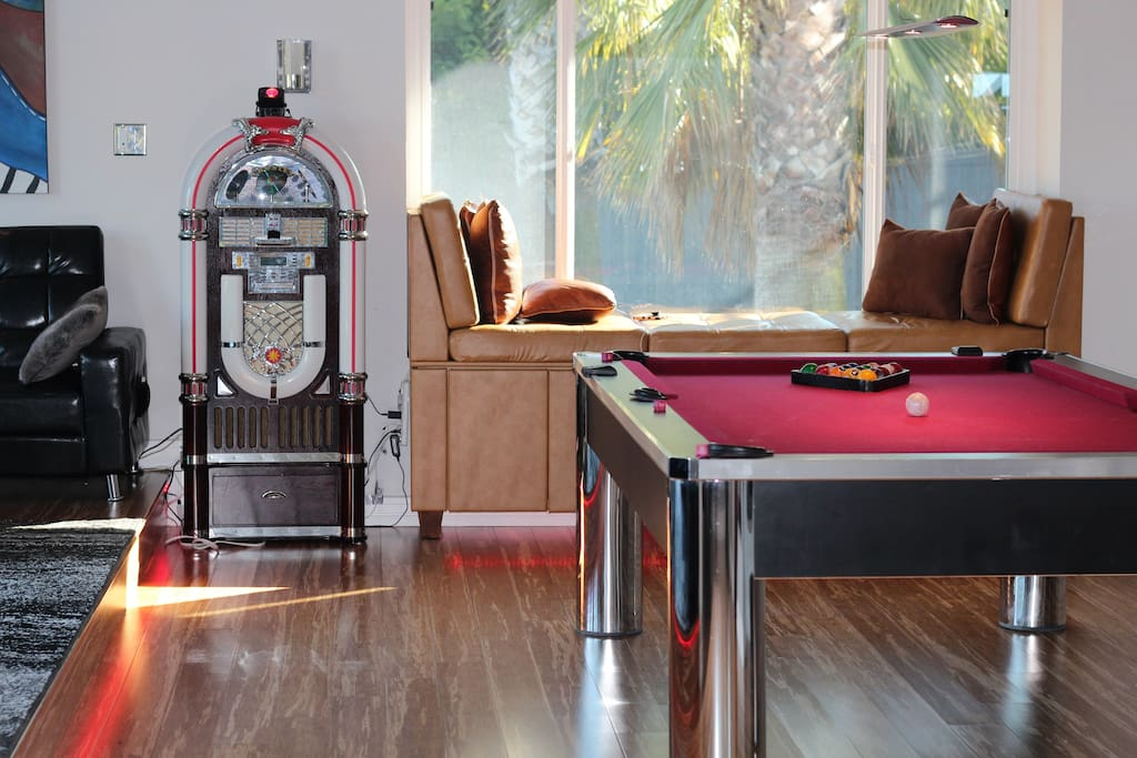 Bay window with cup holders and phone chargers, Bluetooth jukebox with outdoor speakers, pool table.