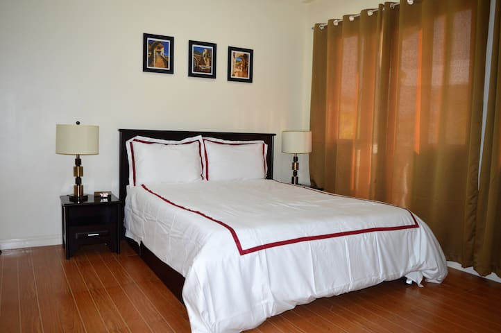Master Bedroom - Queen size bed with good quality spring mattress, linens and duvet