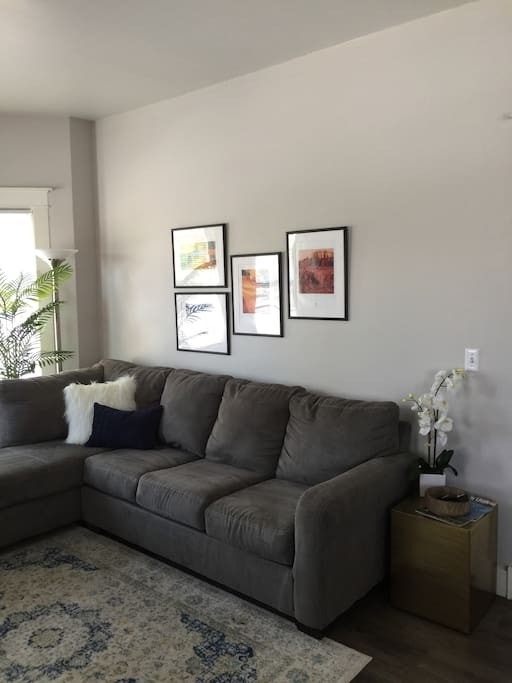 The front room has a couch that you're able to lay flat and sleep on. The unit has plenty of sheets and towels.