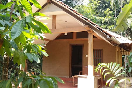 RAJ ESTATE MUD COTTAGE - Madikeri
