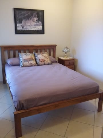 Refurbished queen guest room in executive house