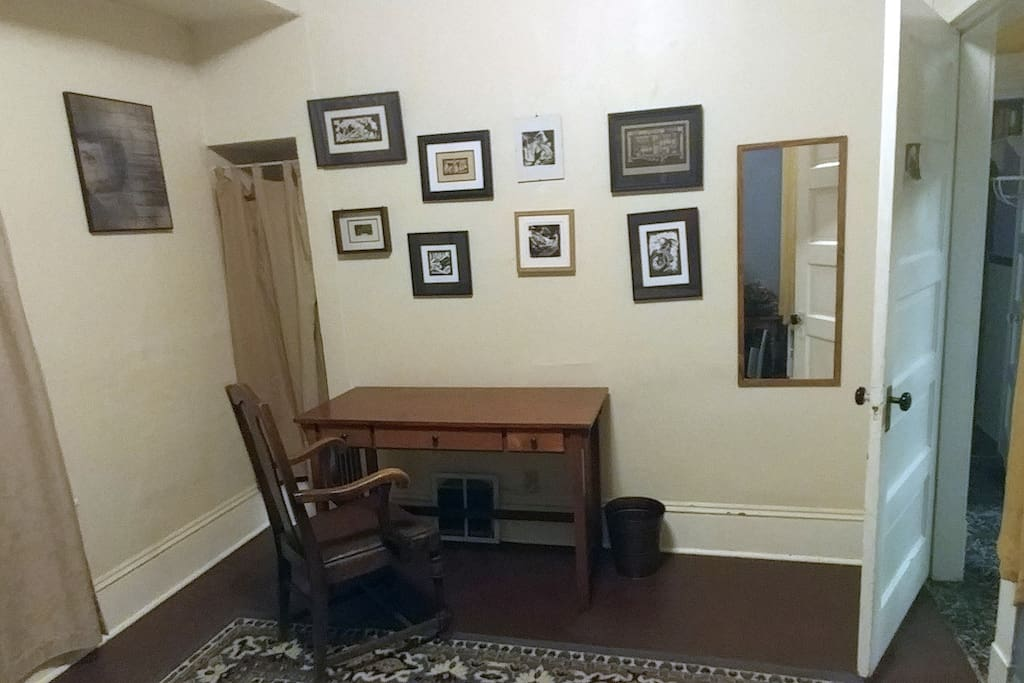 Desk, nook, mirror, and wall art (local artist)!