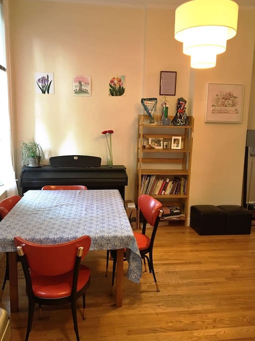 Living Room table with Piano; table and chairs from an Italian restaurant in Brooklyn.