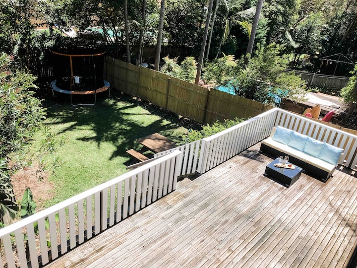 Large backyard for kids and pets, walk to beach.