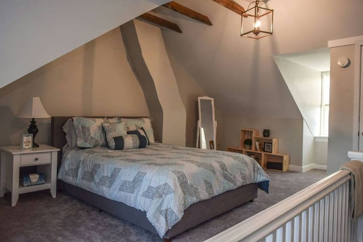 Large loft bedroom with a nice walk in closet