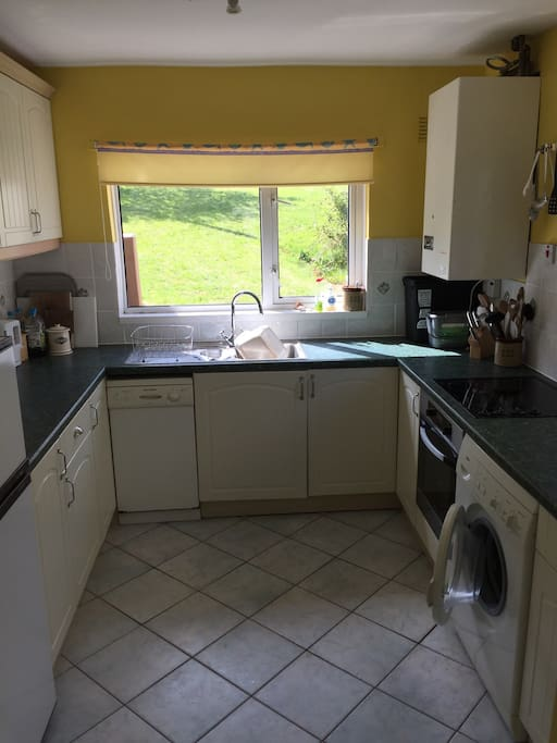 Kitchen, with electric hob and cooker, fridge freezer, slim dishwasher and washing machine