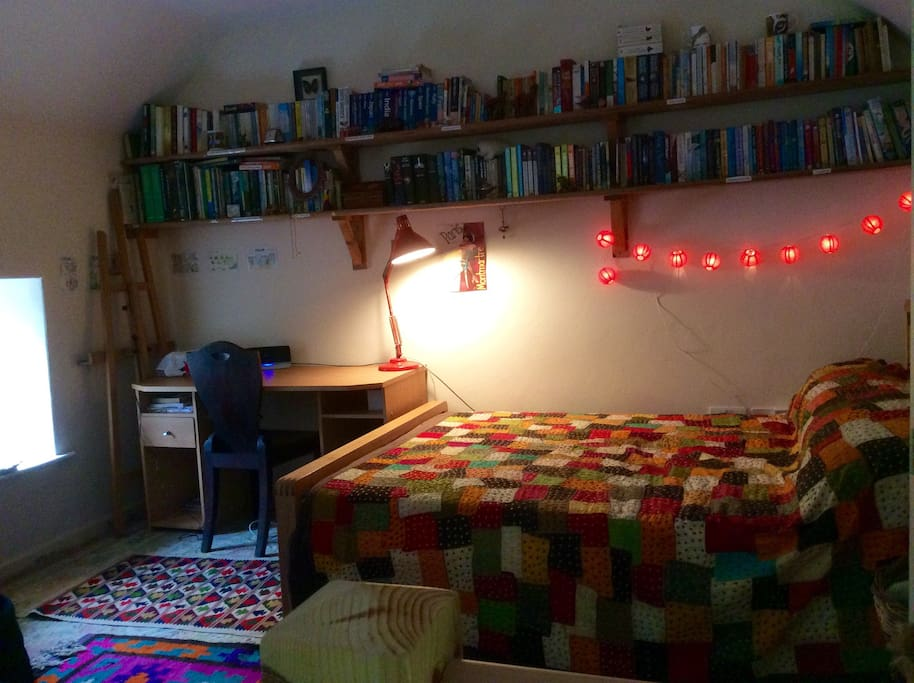 The bedroom has a desk, plenty of books and an Internet connection.