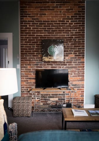 We exposed the brick behind an old fireplace wall.