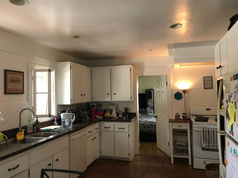 Eat-in kitchen with access to laundry machines.