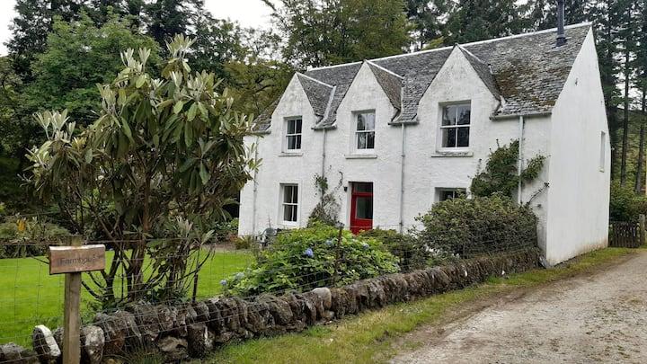 Auchinellan Farmhouse within Scottish estate.