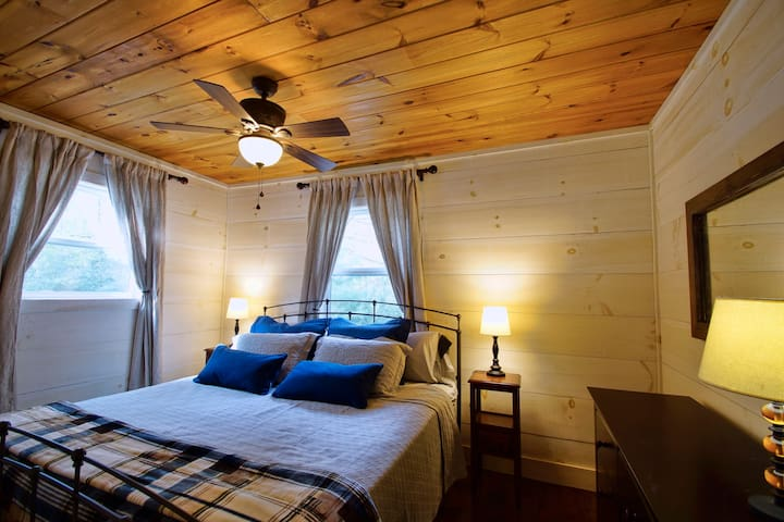 Cozy master bedroom with king sized bed to rest from a busy day hiking and site seeing.
