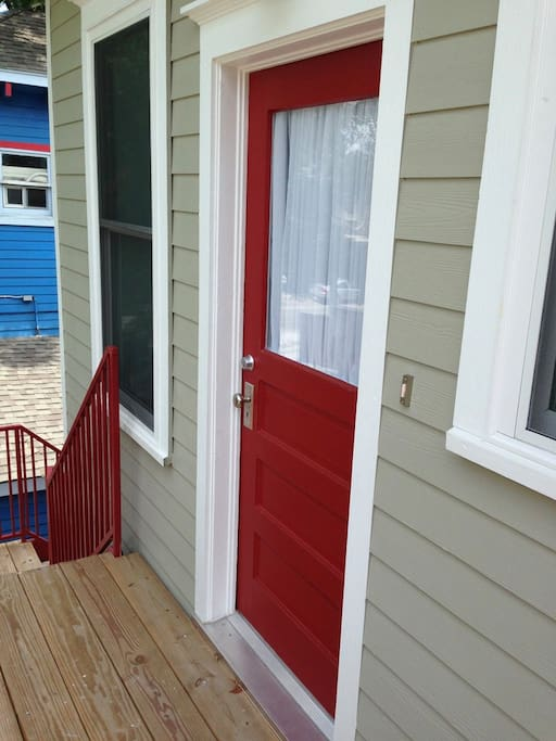 Private apartment entry from large rear 2nd floor deck via outside stairs