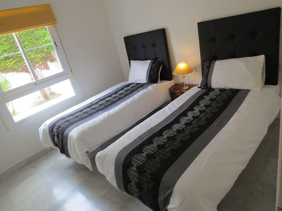 Twin beds in quiet room.