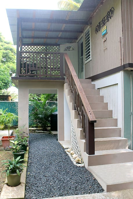 At Ground Level: Gas Grill, Outdoor Shower, and Washing Machine