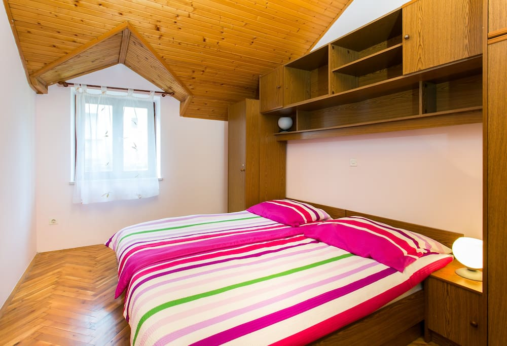 Comfortable bedroom number two with two single beds