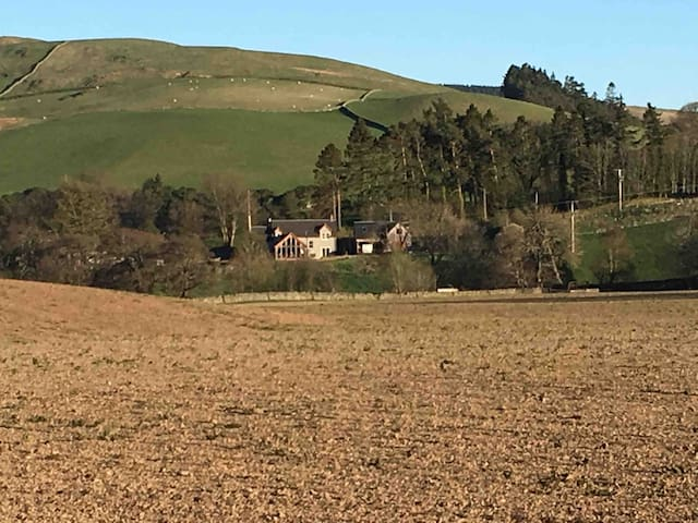 The Barn on the right of the photo next to Dormouse Cottage