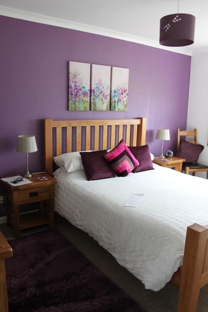 The purple room at Strathallan B&B