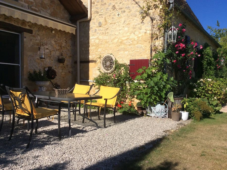 Lovely terrace overlooking the pool, Chateau of Nadaillac de Rouge and the Dordogne Valley.