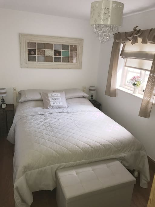 Double bedroom... wardrobe and chest of drawers,  cot bed available on request.