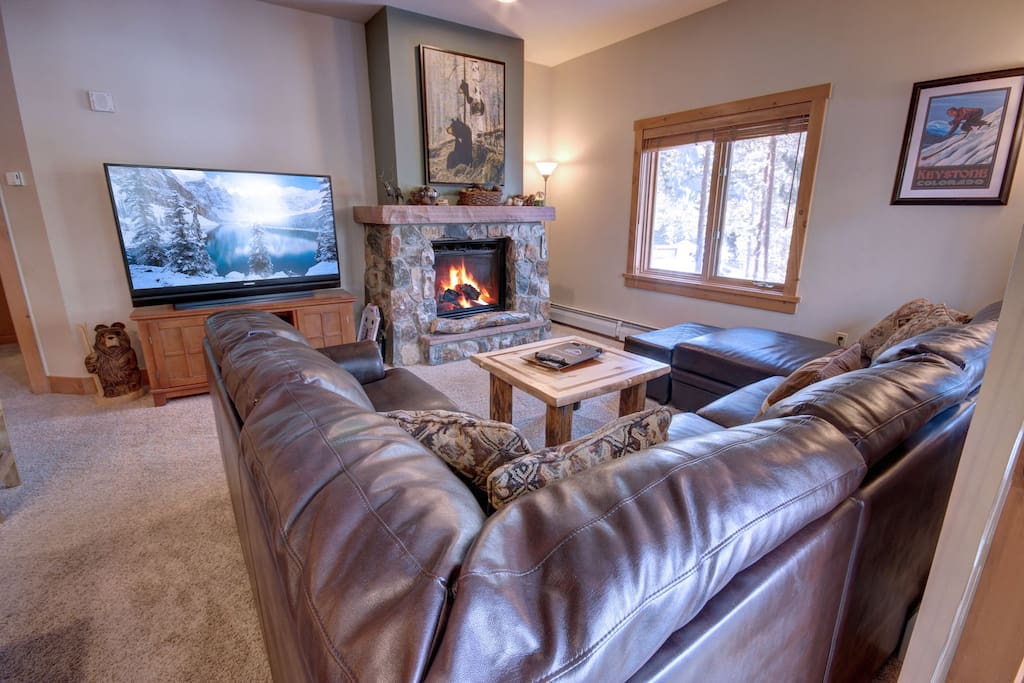 Big cozy couch in living with fireplace.