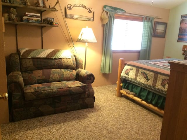 The Fishing Room sleeps two in a Queen Tempur-pedic lodge pole bed.