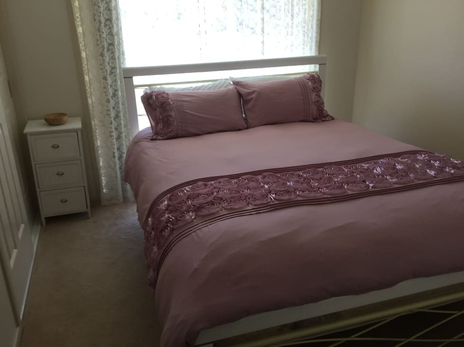 Queen size bed in bedroom 1
