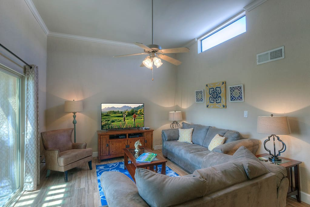 Beautiful, Light and Airy Living Area. High Ceilings - and a gorgeous view of the golf course.