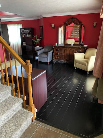 Lounge Area  To the right of the entry way.  This is the floor that gets scratched extremely easily. Please keep pets off as much as possible.