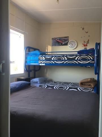 Bedroom 2. Queen bed and Bunks